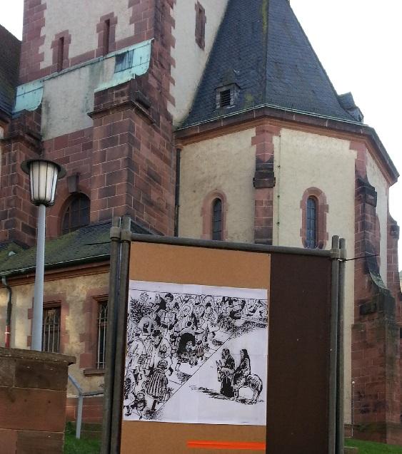 Karikatur mit der Heiligen Familie im Weihnachtskaufrausch vor dem Stadtteilzentrum Vorderer Westen.